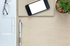 Top view accessories office desk the mobile phone,note paper,laptop. Stock Photos