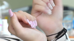 Young female hands, checking the different with the ready manicured nails  Stock Footage