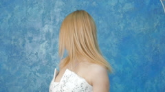 Portrait of a beautiful young blonde in a white dress Stock Footage