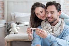 Nice joyful couple recovering from an illness Stock Photos