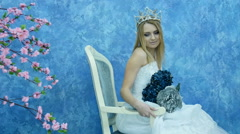 Beautiful young model in the form of Elvish princess. In a white dress Stock Footage