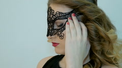 Sexy woman wearing masquerade mask at party. Slow motion Stock Footage