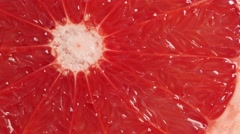 Rotating slice of grapefruit Stock Footage