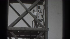 1937: person standing on a huge, industrial structure. SACRAMENTO CALIFORNIA Stock Footage