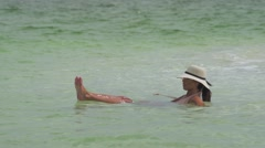 Tourist Floating in the Dead Sea. Stock Footage