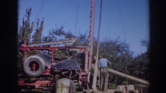 1937: people work to build a structure with a very tall mast with ropes attached Stock Footage