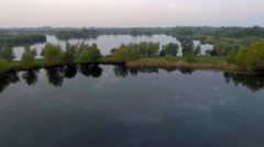 Natural lakes in misty morning. Fastfoward flyby. Aerial shot Stock Footage