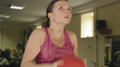 Athlete girl performs exercises ball squats at hard training in the gym close-up Stock Footage