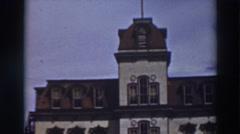 1937: tall, prestigious building standing alone. VIRGINIA CITY CALIFORNIA Stock Footage