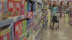 Pretty woman selects products in the supermarket Stock Footage