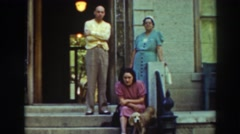 1937: family sitting out on the street corner with their dog. VIRGINIA CITY Stock Footage