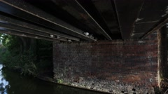 Pigeons hiding under a bridge. Stock Footage