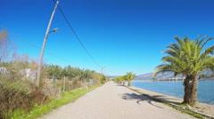 POV vehicle drive car travel coastline touristic palm trees mediterranean sunny Stock Footage
