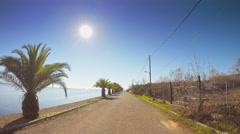 Sunny day POV vehicle drive car travel coastline Mediterranean lagoon Stock Footage