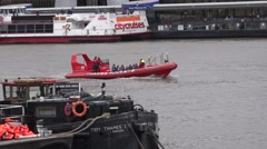 THAMES ROCKETS RIB CARRYING PEOPLE ON  THE THAMES Stock Footage