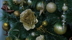 Golden decorations hanging on a Christmas tree Stock Footage