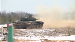Riding a tank and shooting Stock Footage