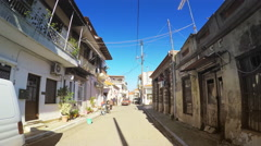Point of view drive car travel narrow street touristic town island sunny POV Stock Footage