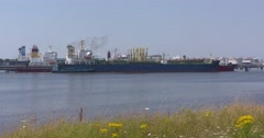 Crude oil tanker berthed, plume of black smoke EUROPOORT, SEAPORT ROTTERDAM Stock Footage