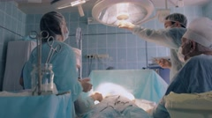 Surgeon turning the light under correct angle to continue surgery Stock Footage