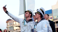 Selfie photos sailors on a mobile phone, men dressed in the form mariners Stock Footage