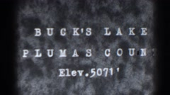 1938: marker gives the site name, location and height above sea level  Stock Footage