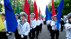 Parade of sailors, men dressed in the form mariner, carry in hand flags of Stock Footage
