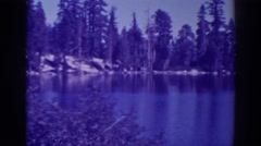 1938: lodges on lower angora lake on a clear day ANGORA LAKES CALIFORNIA Stock Footage