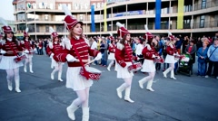 Orchestra drummer girls march on the street, carnival column, girl in costume Stock Footage