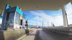 POV pay toll station barrier gate vehicle driving sunny Rio Antirrio bridge Stock Footage