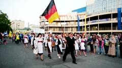 Indigenous Germans, with black and red yellow flags, column, men with German Stock Footage