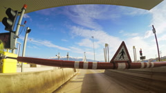 Pay toll station barrier entry fee gate crossing bridge POV vehicle driving car Stock Footage