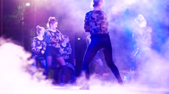Hip hop dancing on stage, young people on stage, an outdoor concert in the town Stock Footage
