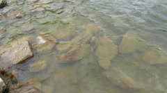 Clear water and a mountain lake Stock Footage