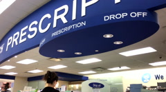 Tilt shot of prescription drop off section inside Shoppers drug mart store Stock Footage