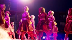 Children on stage, the boys are dancing folk dances in front of the audience Stock Footage