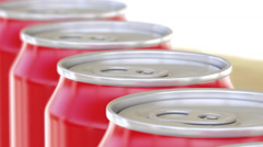Red aluminum cans moving on conveyor. Soft drinks or beer production line Stock Footage