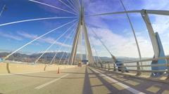 POV vehicle driving Rio Antirrio Bridge car travel blue sky sunny Greece Stock Footage