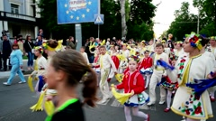 Carnival, children in traditional Ukrainian costumes, go through the city Stock Footage
