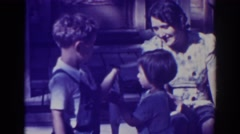 1938: brother handing little sister caught fish to show to camera EL DORADO CITY Stock Footage