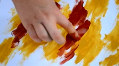HD 1080 girl paints her fingers abstract picture close-up Stock Footage