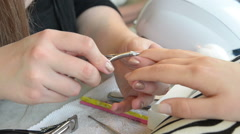 Beautician trimming cuticles of female client Stock Footage