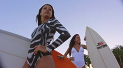 Fashioned And Attractive Twin Sisters Surfers At The Beach Stock Footage
