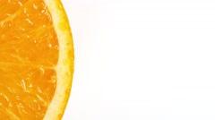 Rotating orange slice Stock Footage