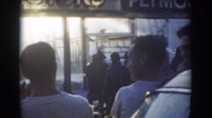 1958: observers standing while firefighters douse burning building and bus  Stock Footage