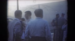 1958: customers and employees in parking lot at mang motors observe fire  Stock Footage