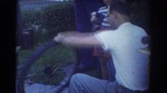 1958: father repairs son's bicycle tire. YORK NEBRASKA Stock Footage
