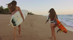 Surf Lifestyle With Two Beautiful Surfers Walking In The Shore At The Sunset Stock Footage