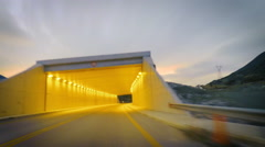 Hyperlapse POV fast vehicle car driving travel road tunnel sunset timelapse Stock Footage
