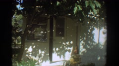 1967: a woman leaving her home in a bathing suit going somewhere FORT LAUDERDALE Stock Footage